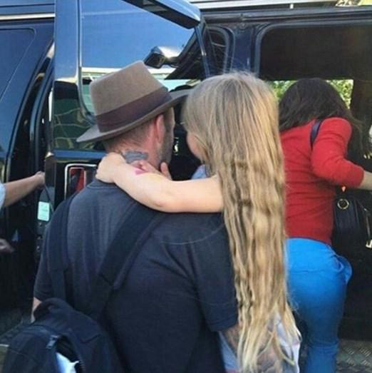 Harper Beckham com o pai